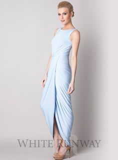 Bessy Dress by Pia Gladys Perey. Beautifully gathered full length gown by Pia Gladys Perey. A high neck dress featuring a gathered wrap style skirt and a stretchy waistband. An elegant and comfortable bridesmaid dress with a difference.