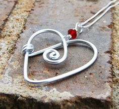 wire heart pendant with bead by dianajo.koriothburleson
