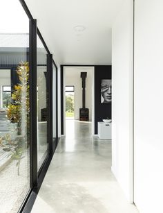 This black-clad home makes a bold statement on the outside, but inside it's warm, welcoming and designed to create the ultimate Kiwi childhood Outdoor Blinds, Outdoor Rooms, Outdoor Living, Carpet Replacement, Clad Home, Pavillion, Old Garage, House Ideas, Affordable Housing