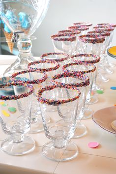 {PARTY CUPS} Dip glasses in white chocolate, then in sprinkles, let harden.