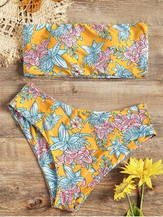 High Cut Floral Bandeau Bikini Set. Sunbathe in style in this two-piece floral print swimsuit set. The allover floral print accents on the top and bottom add a beautiful look that catches the eyes. The bandeau top with soft pad, high waisted swim bottoms is a flattering detail. The soft and stretchy material, you can have even more fun with this swimwear. #zaful #bikinis #swimwear