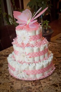 This beautiful White and pink butterfly baby girl diaper cake would be perfect as a gift or centerpiece for your next baby shower! This diaper cake is made-to-order and will include diapers. Baby Cakes, Baby Shower Cakes, Deco Baby Shower, Fiesta Baby Shower, Shower Bebe, Baby Shower Diapers, Girl Shower, Baby Shower Parties, Baby Shower Gifts