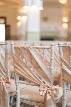 Satin Ribbon Sashes on Ceremony Chairs | Blue Rose Photography