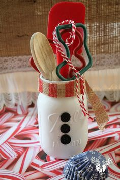 Make Mason jars into snowmen, to be filled with anything from kitchen utensils to red roses! TGtbT.com is thinking white paint, self-adhesive black felt buttons, plaid ribbon mufflers! GREAT thrift shop display and gift idea!
