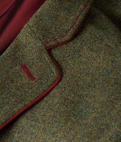When it comes to menswear attention to detail is crucial. This lapel is the perfect example with its read stitching.