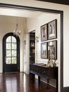 This is such a sleek & chic interior! This entryway is simple, yet has some ornate elements that elevate it to awesome. Plus, gotta love all the dark wood!