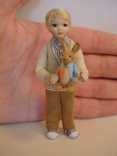 dollhouse miniature boy with his Peter Rabbit toy