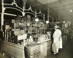 A woman shopping for groceries in the 1920's.