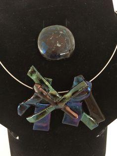 Bronskleurig glazen hanger en ronde ring iriserende kleuren