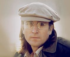 John Lennon, 1940-1980, English musician and singer-songwriter who rose to worldwide fame as a member of The Beatles, one of the most successful acts in music history.