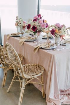 Coastal views, boho blooms and rattan wedding details everywhere you look... this New Jersey wedding inspiration is replete with inspiration for the modern bohemian bride. The neutral palette is enhanced with textural decor like dried palm fronds and wooden wedding signage, but the real star of the show is the bridal bouquet dripping with orchids and lunaria. See the full elopement inspiration on Ruffled now! #bohochicfashion #driedflowers #bohemianwedding #thewaveresort