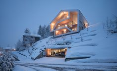 """This spectacular Swiss chalet"""" is a picture perfect retreat located in Anzère, Switzerland. Designed by SeARCH, the spectacular Swiss Alps minimalist chalet was built on a steep hillside plot and features three-levels, guest house downstairs, the ma Residential Architecture, Amazing Architecture, Contemporary Architecture, Interior Architecture, Dynamic Architecture, Architecture Wallpaper, Contemporary Interior, Casa Bunker, Grand Chalet"""