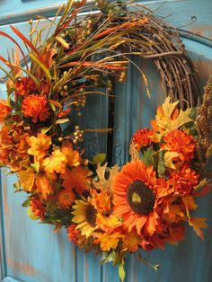 Fall Foliage/ Harvest Fall wreath with leaves, berries, and sunflowers in orange and yellow hues- Thanksgiving wreath. , via Etsy.