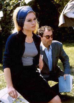 Brigitte Bardot with director Jean-Luc Godard on the set of Le Mepris, 1963.