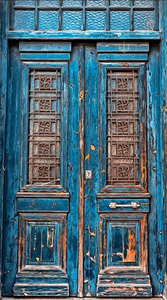 Weathered blue doors in Athens, Greece.