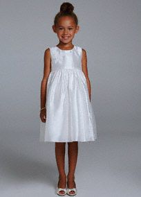 Simple yet beautiful in design, this will be the perfect flower girl dress with perfectwear again potential!  Tank taffeta bodice features delicate floral detailing.  For a splash of color add a ribbon at the waist.  Fully lined. Back zip. Imported polyester.Dry clean only.
