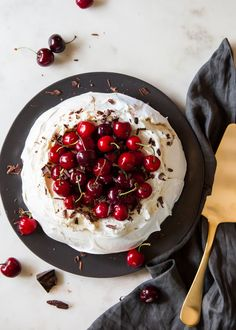 Chocolate Cherry Pavlova: Pavlova with almond cream, fresh cherries, and chocolate shavings. - Style Sweet CA