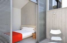 SCREENS & SHUTTERS: The Other Window Treatments  |  The rooms at Hotel Sezz, Saint-Tropez are outfitted with a combination of double height sliding screens, glass doors and curtains – allowing for varying degrees of exposure and privacy. Design by Christophe Pillet. Photo by Manuel Zublena.