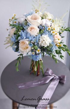 Blue and light peach wedding bouquet