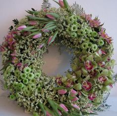 Holy smokes.  Designed with cymbidium orchids, tulips & limo