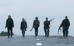 A BAND APART: The survivors of a post-apocalyptic something or other wander the landscape in The Day.