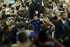 The longest walk: Messi walks up the tribune to collect the second place trophy...