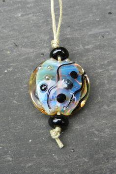 Milky Core Swirl Focal Lentil by LouiseHallGlassArt on Etsy https://www.etsy.com/listing/552669134/milky-core-swirl-focal-lentil