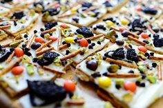 Halloween bark - graham crackers, almond bark, pretzels, Oreos, Reese's pieces, mini chocolate chips, and nuts.