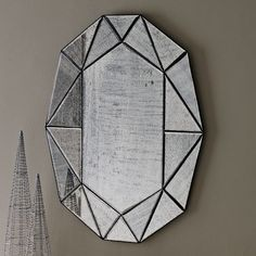 Decorating Tip:  Add mirrors to add instant style to your home, like the Gem Mirror available at west elm.