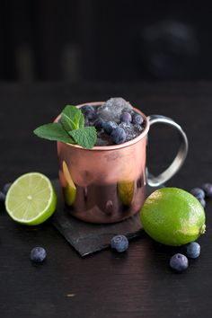 Berry Moscow Mule from www.THEDASHINGRIDER.com with Crystal Head Vodka, Goldberg Ginger Beer, Blueberries and Cranberry Syrup #cheers #cocktail #longdrink #coppermug