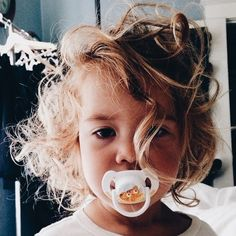 Little girl with curly blond hair