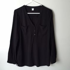 Black Long Sleeve Blouse Classic and versatile black long sleeve blouse, henley style three buttons in the front with pockets. Easy to wash and wear! 100% rayon Old Navy Tops Blouses