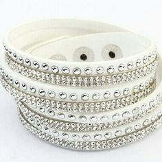 "New white studded wrap bracelet Beautiful white, silver and rhinestone double wrap bracelet.  Total length 16"".  3 adjustable snap sizes!! Jewelry Bracelets"