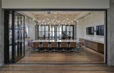 Custom Lighting designed by Matthew McCormick Studio. Earls Head Office. Vancouver, Canada. Follow us: http://instagram.com/matthew.mccormick/  #Custom #Brass #Lighting #Design #Interiordesign #Interior #Decor #Architecture