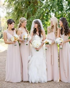 "See the ""Blush Bridesmaids"" in our A Formal Garden Wedding in Georgia gallery. Soft pink floor-length Joanna August gowns from Bella Bridesmaid."