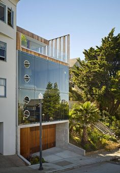 Facade, Concrete and Glass, Wooden Garage Door Peter's House by Craig Steely Contemporary House in San Francisco