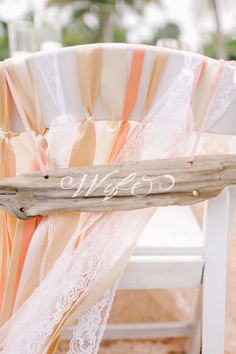 Ribbon and a driftwood sign: http://www.stylemepretty.com/2014/08/12/intimate-playa-del-carmen-destination-wedding/ | Photography: Brandon Kidd - http://www.brandonkidd.net/