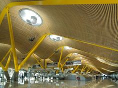 Terminal 4 of Madrid's Barajas airport is an award-winning piece of architecture. Two-thirds of a mile long, terminal 4 at MAD won the Stirling Prize for architecture when it opened its doors in 2006. The way the color-coded beams that