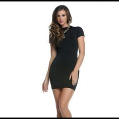 """Black Exposed Backside Mini Dress #884561-BLAS Short sleeve bodycon dress with large backside cutout. 92% Polyester 10% Spandex. Bust 30"""", waist 24"""", hips 28"""", length armpit down 23"""". Blvd Collection Dresses Mini"""