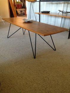 Teak coffee table with custom Kurrlson base