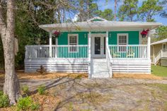 For sale: $225,000. Adorable beach cottage in the popular and reserved Point Washington area only 3 blocks from the bay! A beautiful wrap around covered porch welcomes you home and the open floor plan of this house boasts several windows bringing the outdoors in. The home has impressive hardwood floors throughout the living, dining & kitchen areas. Recessed can lighting, elegant pendant lights and upgraded fans throughout the home too! A charming matching art studio at the back of the pro...