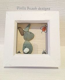 New for 2017 as part of our bunny collection we have created this bunny using sea tumbled grey pebbles detailed with a white milk glass tail.  Busy bee created with a dainty vibrant orange seaglass piece.  Set in a satin white wooden ( new) box frame measuring 10cm square & 4 cm deep approx with wall hanger.  All our gifts & items are handmade, never mass produced so are truly bespoke , buy unique for your loved ones , perfect for Easter.