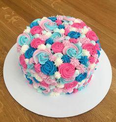 Gender reveal cake - chocolate cake and vanilla buttercream.