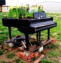 Would love to do this or the waterfall, someone is always getting rid of a piano they don't want anymore, I just don't know about the weather-proofing of it