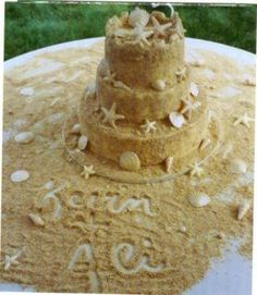 """sand cake""... using graham cracker crumbs or vanilla oreos... cute doen in a bucket too for summer bdays!"