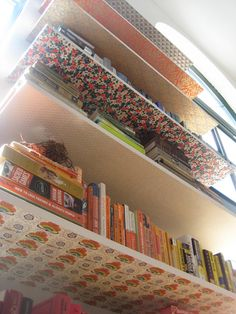 wallpaper scraps bookshelf for reading area, via apartment therapy