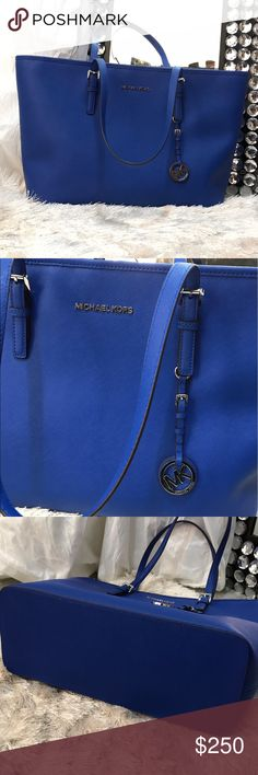 Michael Kors jet set electric blue Used once since purchased in March. I'm just not a fan of the divider. Like new condition since I used it once for a short period during church. Please submit reasonable offers through offer link. No trades at this time. Thank you Michael Kors Bags Totes