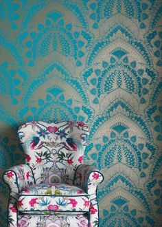 """I never tire of the peacock's majestic, symmetrical beauty. I wanted to capture its essence but in a fresh new way so set about a graphic repeat pattern using solid blocks of colour and treating the design as if it were a fine, intricately-woven lace."" Turquoise Blue & Gold Azari Wallpaper - Wallpaper - Matthew Williamson."