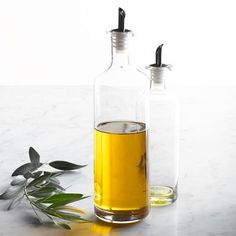 Shop olive oil dispenser from Williams Sonoma. Our expertly crafted collections offer a wide of range of cooking tools and kitchen appliances, including a variety of olive oil dispenser. Olive Oil Container, Glass Beverage Dispenser, Olive Oil Dispenser, European Kitchens, Kitchen Utensils, Kitchen Tools, Kitchen Ideas, Kitchen Stuff, Kitchen Gadgets