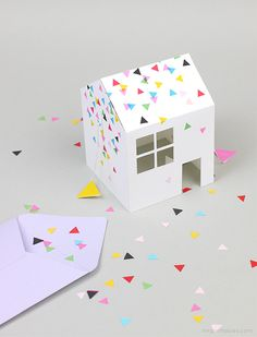 This little party invite can pop out of your envelope into a 3D house.